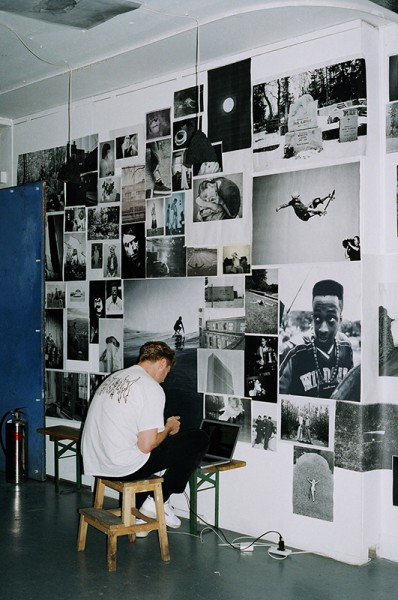 The Photocopy Club, MAN SITS IN FRONT OF WALL OF PHOTOCOPIED IMAGES