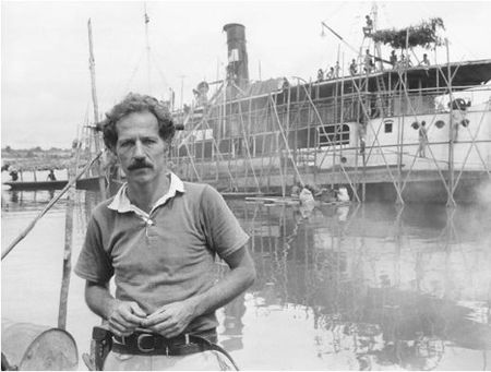 Fitzcarraldo, boat, man standing in front of water