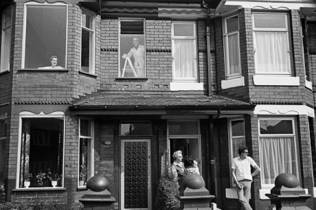 Black and white view of houses and occupants outside, Martin Parr, Manchester